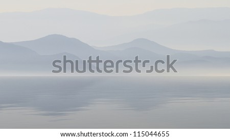 Scenic view of lake with mountain reflections