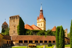 Scenic view of lutheran fortified church and evangelical cemetery in Cristian, Brasov County, Romania. Complex was built in the 15th century by the Transylvanian Saxon community.