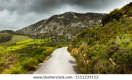 Scenic view of mountain road against sky, Crete, Greece #1511239112