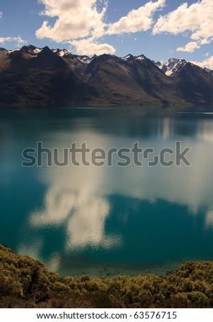 Scenic view of mountainous Lake Wakatipu near Queenstown, South Island, New Zealand - stock photo