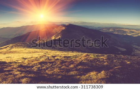 Scenic view of mountains, autumn landscape with colorful hills at sunset.Filtered image:cross processed vintage effect.