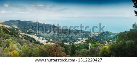 Scenic view of mountains with houses by Mediterranean Sea