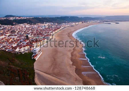 Scenic view of Nazare town and beach from overlooking cliffs during early evening