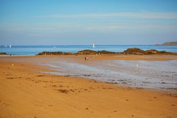 Scenic view of Plage du Sillon beach in Saint-Malo, Brittany, France. Photo taken at low tide