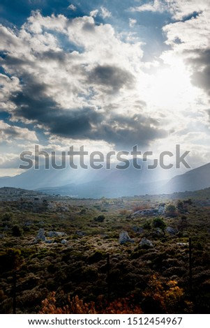Scenic view of plants on mountain landscape against cloudy sky, Crete, Greece