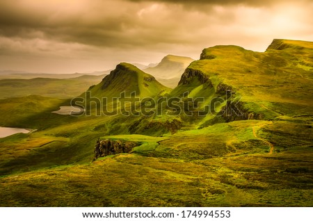 Scenic view of Quiraing mountains sunset with dramatic sky in Scottish highlands, Isle of Skye, United Kingdom #174994553