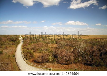 Scenic view of road receding through Shark Valley in the Everglades National Park, Miami, Florida, U.S.A.