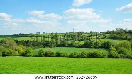 Scenic View of Rolling Countryside of Green Fields in the Avon Valley in Wiltshire England