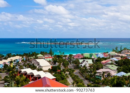 Scenic view of roof tops on tropical island. - stock photo
