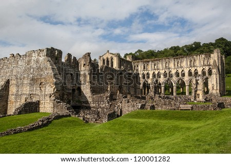 Scenic view of ruins of Rievaulx Abbey under cloudscape, North Yorkshire Moors, National Park, England