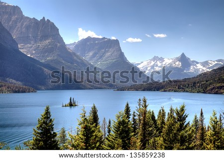 Scenic view of Saint Mary Lake with snow capped mountains in background #135859238