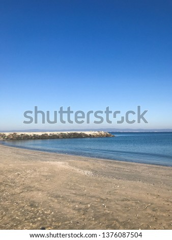 Scenic View Of Sea Against Clear Blue Sky and Sunlight #1376087504