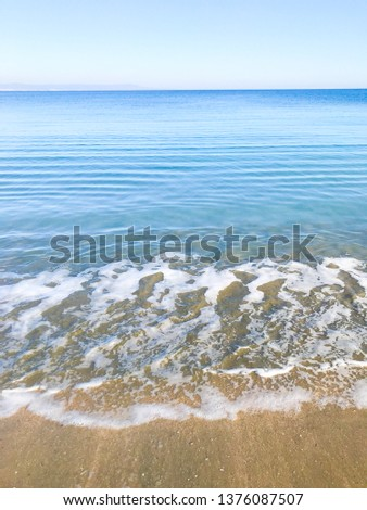 Scenic View Of Sea Against Clear Blue Sky and Sunlight #1376087507