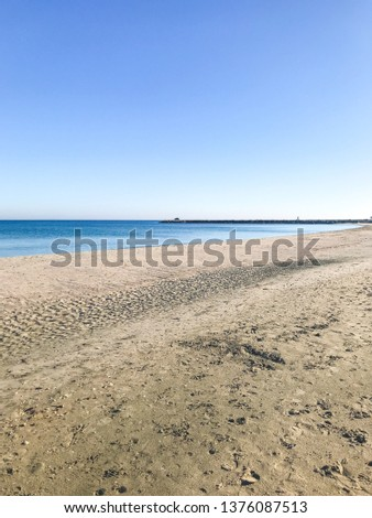 Scenic View Of Sea Against Clear Blue Sky and Sunlight #1376087513