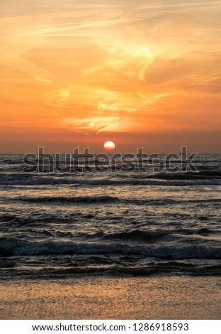 Scenic View Of Sea Against Orange Sky #1286918593