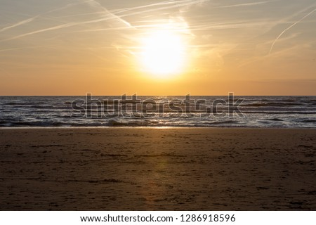 Scenic View Of Sea Against Orange Sky #1286918596
