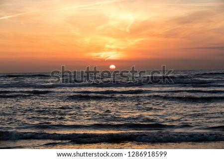 Scenic View Of Sea Against Orange Sky #1286918599