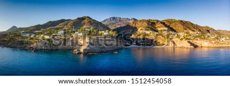 Scenic view of sea and mountain against cloudy sky, Crete, Greece