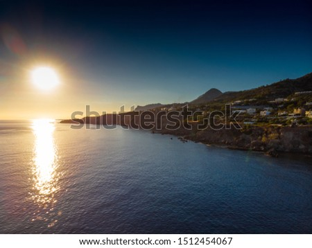 Scenic view of sea and mountain during sunset, Crete, Greece