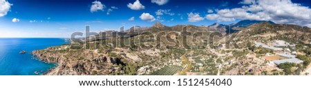 Scenic view of seascape with agricultural field on mountain, Crete, Greece