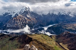 Scenic view of snow-capped mountains of the Swiss Alps skyline seen from the Schilthorn, a summit in the Bernese Alps above the village of Murren in Lauterbrunnen, Switzerland