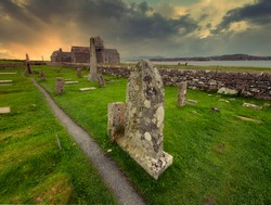 Scenic view of the ancient cemetery, Relig Odhrain, final resting place of numerous kings and queens as well as the ancient chapel, St. Oran on Isle of Iona, Scotland