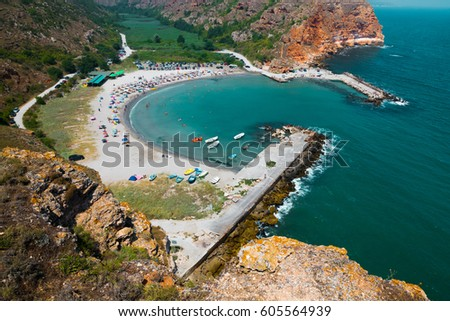 Scenic View of the Bolata bay, Bulgaria. Black sea resort dotted with boats and tourists on beach surrounded by hills from birds eye view #605564939