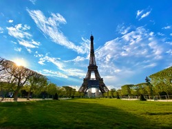 Scenic view of the Eiffel tower with bright blue sky in Paris, France. Empty Parisian streets during coronavirus quarantine and lockdown. Popular tourist destinations