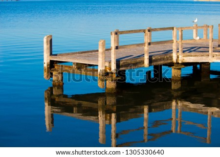 96df48d730 Scenic view of the little wooden Pump jetty reflected in the calm  Leschenault Estuary at Bunbury