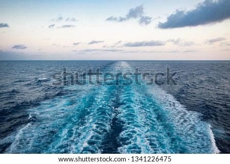 Scenic view of the sea from the stern of a luxurious cruise ship, against the sunrise on a beautiful blue sky. Orizontal view. #1341226475