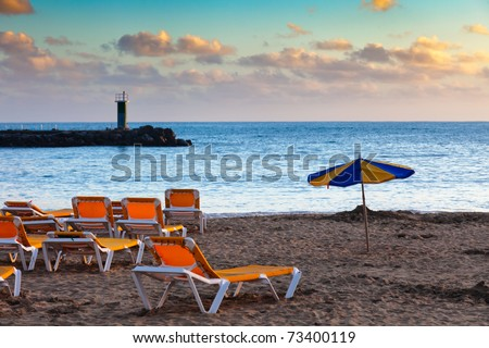 Scenic view of tourist beach of Puerto Rico on island of Gran Canaria.