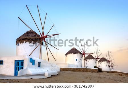Scenic view of traditional greek windmills on Mykonos island at sunrise, Cyclades, Greece