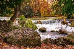 Scenic view of waterfall on Isar river in English Garden Park, Munich, Germany.