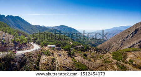 Scenic view of winding road and mountain against sky, Crete, Greece #1512454073