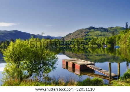 Scenic view of wooden pier on lake Ullswater, Lake District National Park, Cumbria, England.