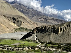 Scenic view on Himalayan mountains in kingdom of Mustang, Nepal. Picturesque green Kali Gandaki valley. Spectacular tibetan landscape. Dhaulagiri range. Annapurna circuit. Magnificent natural beauty.