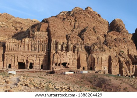 Scenic view on the beautiful carved tomb facades on the Street of Facades in a famous historical and archaeological city of Petra, Wadi Musa, Jordan #1388204429
