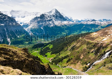 scenic view over grindelwald with Eiger mountain peak in spring, Switzerland