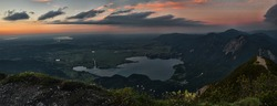 scenic view to alpine foothills and lake kochelsee at sundown, upper bavaria