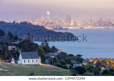 Scenic views of Old St Hillary's Church, Angle Island, Alcatraz Prison, San Francisco Bay and San Francisco Skyline at dusk. Shot from Tiburon, Marin County, California, USA. #1394472344
