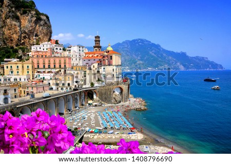 Scenic village along the Amalfi Coast of Italy. View of Atrani with flowers against the blue sea during summer. #1408796690