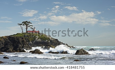 Scenic west coast shoreline view of Battery Point Lighthouse in Crescent City California along the blue waters of the Pacific Ocean