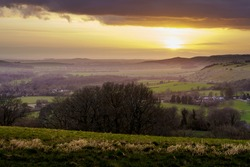 scenic Westerly view as the golden sun sets over Oare and across the Pewsey Vale valley, North Wessex Downs AONB