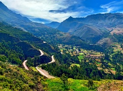 Scenic winding roads to Sacred Valley Incas Urubamba Peru majestic Andes mountains at summer season. Idyllic landscape of South America, spectacular views of beautiful peaceful nature Cuzco region.