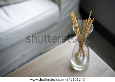 Scent sticks aromatic in jar on table