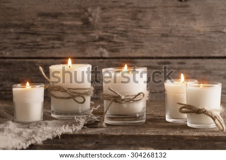 scented candles on old wooden background #304268132