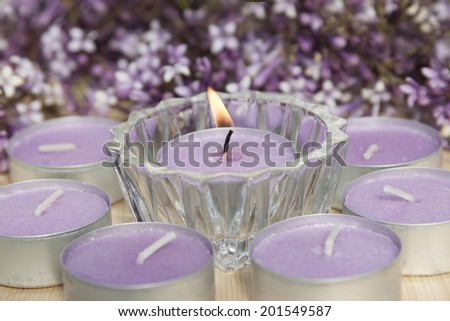 Scented candles with the scent of lilacs.