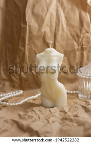 Scented Woman torso candle. Aroma candle in the shape of a female body. Stock photo ©