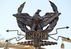 scepter with an eagle and the letters SPQR (Senatus Populus Romanus). Icon government of ancient Rome