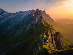 Schaefler mountain ridge swiss Alpstein, Appenzell Switzerland, steep ridge of the majestic Schaefler peak, Switzerland. couple man and woman mid age in the mountains, man and woman hiking